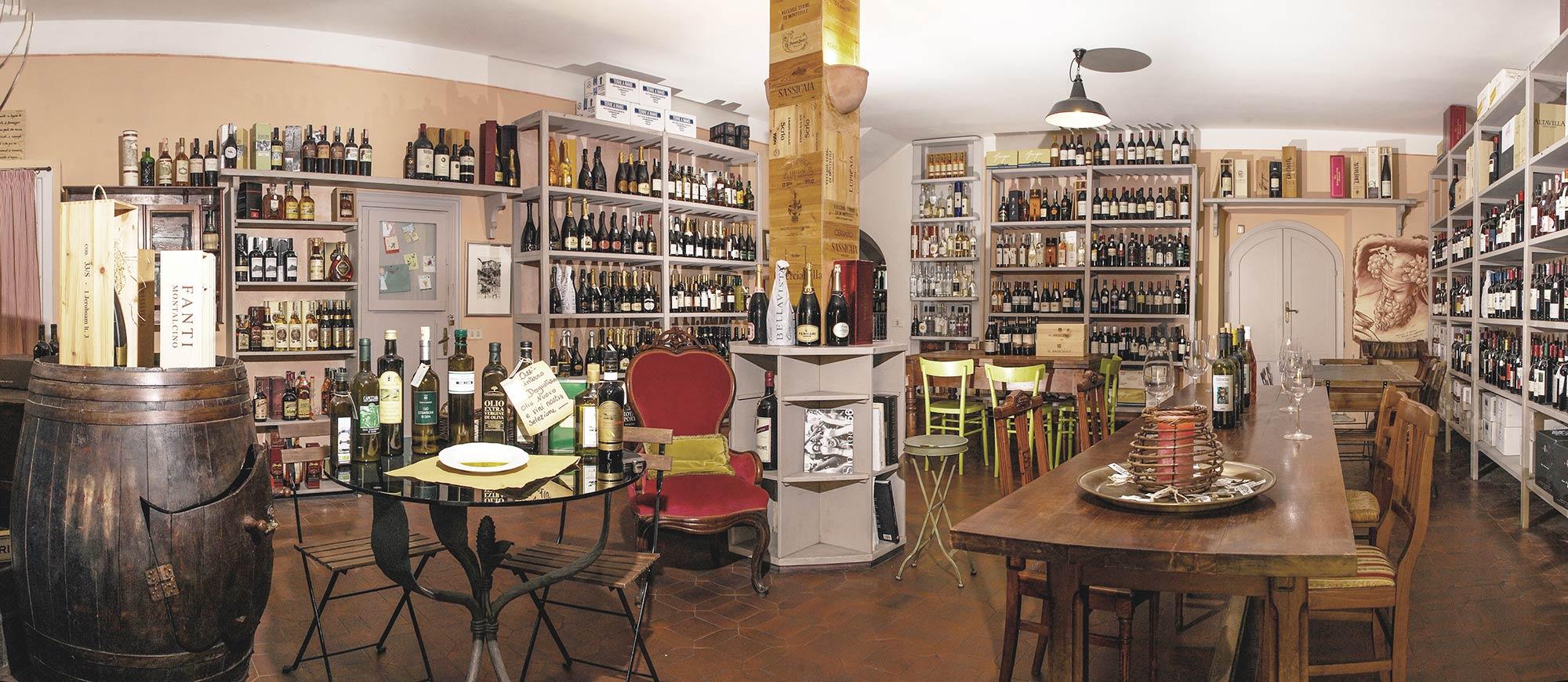 L'interno di Cantine Angeli, con pareti stipate di vini e oli